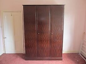 A stag minstrel 3 door wardrobe, ideal for shabby chic , or as it is