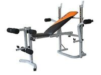 folding weight lifting bench (not used much) with weights and bars