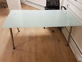 Ikea glass top desk in great condition.