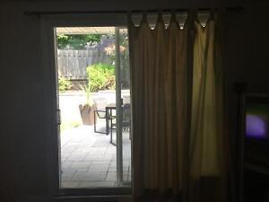 Beige Curtains and Curtain Rod