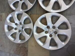BRAND NEW  MAZDA 3  FACTORY OEM  16 INCH WHEEL COVER SET OF FOUR..