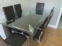 Chrome and Glass Dining Table with 6 Faux Leather Chairs