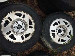 4-205/70r14 A/S TIRES ON FORD ALLOY RIMS $200 OBO