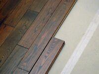 Perform installation of laminate flooring.