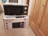 New and boxed Morphy Richards microwave.