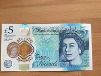 Plastic 5 pound note