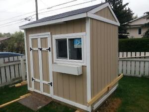 Cute new shed 6'X8'X8'h double doors, opening window and bench.