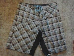 Size 38 REEF male shorts/trunks - Never worn