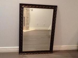 Mirror with brown frame
