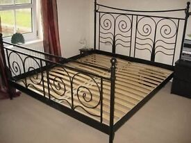 Ikea black metal double bed frame and mattress for sale.