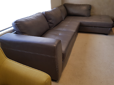 Corner leather lounge with otomon