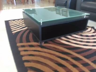 Solid Black Coffee Table With Glass Top
