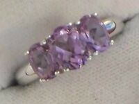 LADIES RING INSET WITH 3 GENUINE AMETHYSTS SIZE P THE RING IS IN EXCELLENT CONDITION