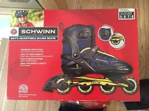 2 pairs of boys Schwinn Adjustable In-Line Skates