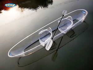 2 clear tandem kayaks with paddles