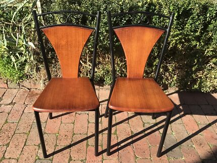 Rare pair of vintage solid wood timber wrought iron dining chair