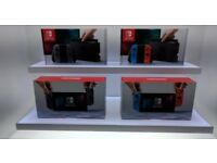 NEW Nintendo Switch NEON & GREY UK genuine with store receipt and 1 year Warranty