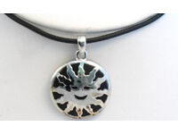 Sun pendant on black cord. Cord measures aprox 40cm with a 4cm extension chain - JTY344