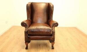 tan leather armchairs