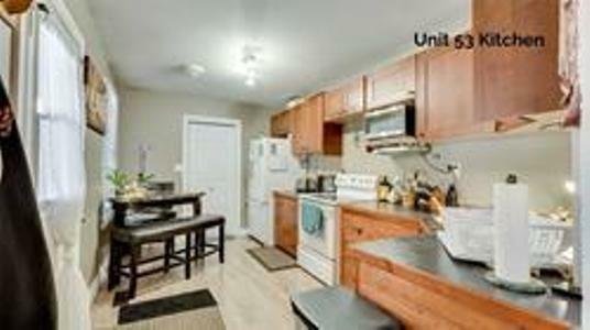 for sale sprawling legal nonconforming triplex  houses