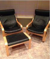 Two black leather Ikea Poang chairs and foot stools