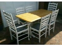 White wooden farmhouse table and chairs