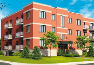 Condo  2e etage coin Garage possibilité de 2 condo pour 350000