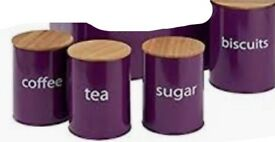 Aubergine coloured canisters,tea coffee, sugar and biscuits. In good condition used only twice