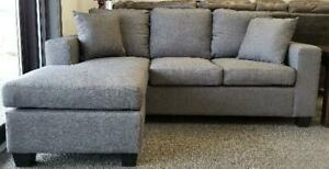 14.99% Financing Available!!  New in Boxes!  Charcoal Fabric Sectional Now Just $699 Taxes Included with Free Delivery