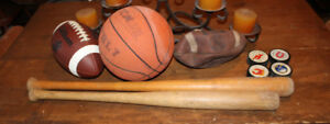 baseball bats footballs pucks and basketball