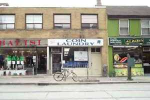 Downtown coin laudrromat on busy Queen st W