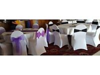 100 white spandex chair covers, used but in good condition