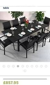 Brand new table with 8 chairs.