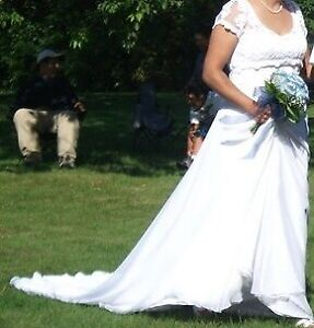 Wedding dress with veil for $150.00 0r BO.