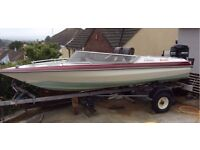 Beautiful boat for sale. With trailer and great condition Mercury 50 engine.