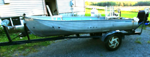 12 foot aluminum boat and homemade trailer.