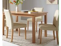 New Primo dining table and chairs very little use excellent condition recently reduced. T