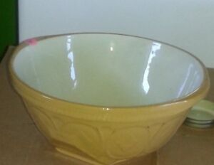 2 mixing bowls - $25.00 each (Yellow and white vintage bowls)