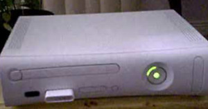 xbox 360 with 2 fall out games and one red controller