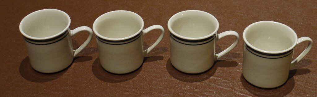 SET OF FOUR MUGS - OFF WHITE COLOUR WITH BLUE RINGS AT TOP - NEW