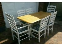 White wooden farmhouse dining table and chairs