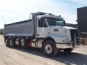 Dump truck tri axle for rent, hire, and construction
