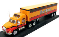 HO train layout - collectible Matchbox semi-trailer beer trucks