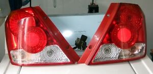TAIL  LIGHTS  Driver & Passenger  2 Complete Sets CHEV AVEO 2004