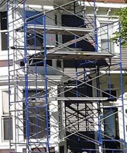 Scaffold with planks and jack legs