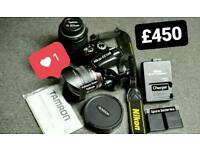 Nikon D5100 DSLR Camera with 18-200mm zoom lens and 8mm fisheye lens