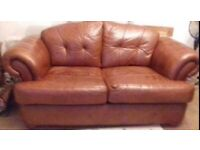Brown leather studded suite