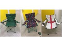 three folding camping or picnic chairs