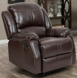 Floor Model Reclining Chair in a Brown PU