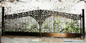 Metal gate for the driveway with cast iron decor